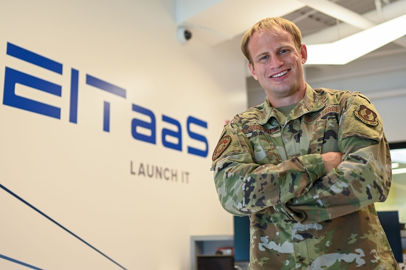 Capt. Andrew Beckman, an Enterprise Information Technology-as-a-Service program manager, poses for a photo at the Hanscom Air Force Base, Mass., Collaborative Nerve Center Aug. 23.