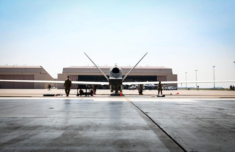 A global hawk sits in the hangar.