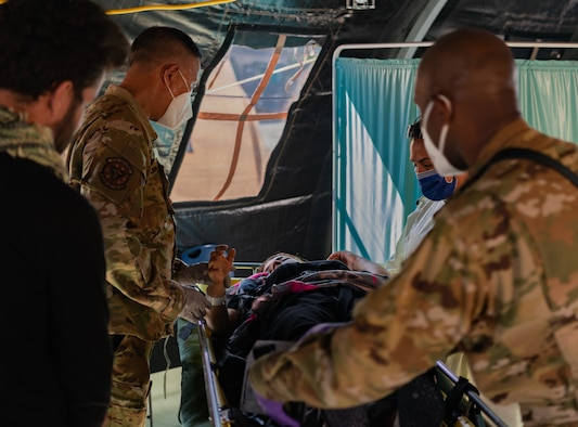 Airmen provide post labor care to mother.