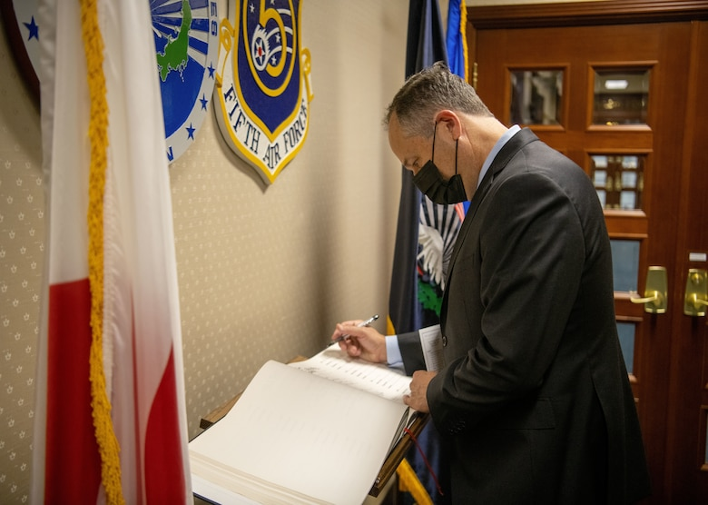 Second Gentleman of the United States, Douglas Emhoff signs the USFJ visitor's book at the USFJ Headquarters building at Yokota Air Base, August 23, 2021. The guest book was introduced at the opening of USFJ headquarters for historical documentation and has been signed be every distinguished visitor ever since.  (U.S. Air Force photo by Staff Sergeant Braden Anderson)