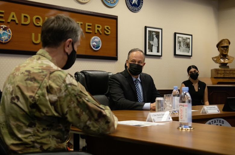 U.S. Air Force Lt. Gen. Kevin B. Schneider, U.S. Forces Japan commander, left, gives Second Gentleman of the United States, Douglas Emhoff a USFJ command briefing in the MacArthur Conference Room during his visit to Yokota Air Base, Japan, August 23, 2021. Emhoff visited Japan to familiarize himself with USFJ and its mission. (U.S. Air Force photo by Staff Sergeant Braden Anderson)