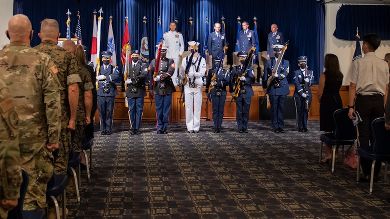 Joint U.S. Forces Japan color guard members present the colors during the USFJ and 5th Air Force change of command ceremony at Yokota Air Base, Japan, Aug. 27, 2021.