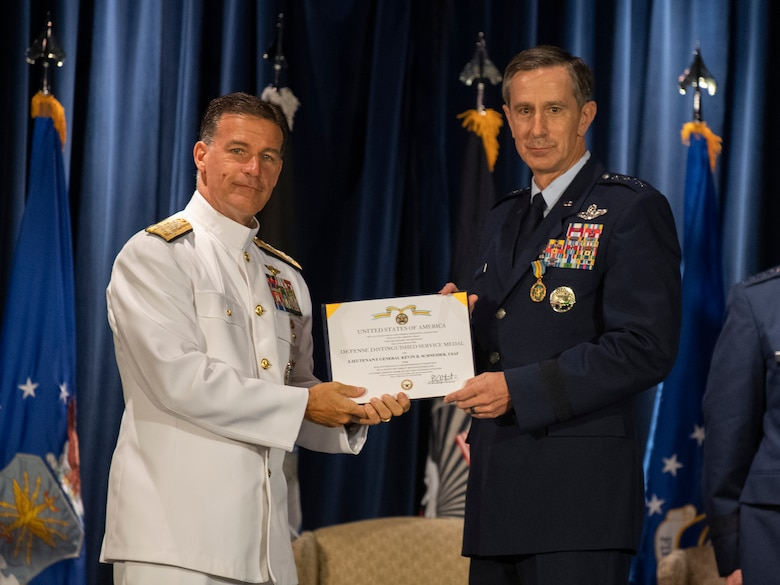 Admiral John C. Aquilino, U.S. Indo-Pacific Command commander, presents the Defense Distinguished Service award to Lt. Gen. Kevin B. Schneider, U.S. Forces Japan and 5th Air Force outgoing commander, during the USFJ and 5th AF change of command ceremony at Yokota Air Base, Japan, Aug. 27, 2021.