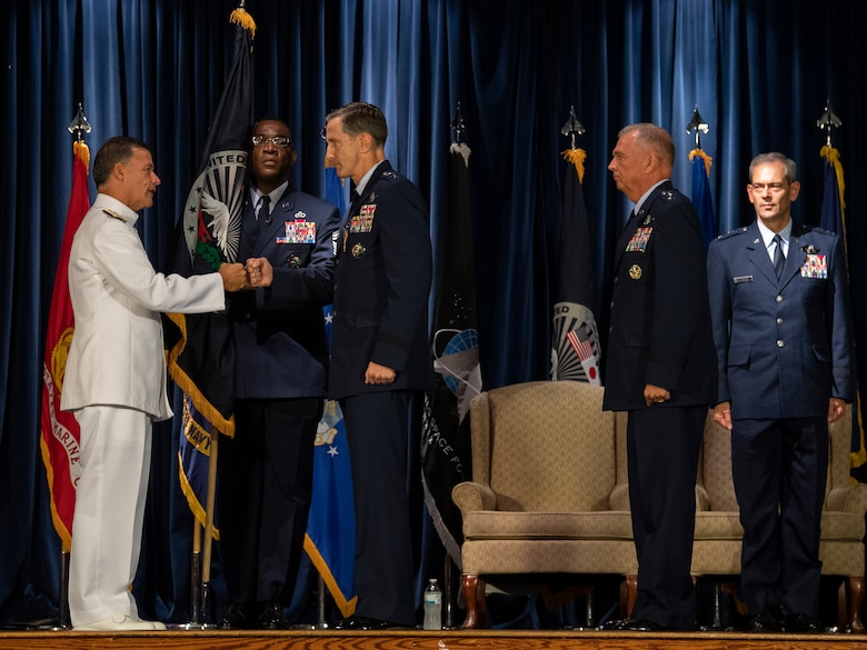 Admiral John C. Aquilino, left, U.S. Indo-Pacific Command commander, thanks Lt. Gen. Kevin B. Schneider, center, U.S. Forces Japan and 5th Air Force outgoing commander, for his service during the USFJ and 5th AF change of command ceremony at Yokota Air Base, Japan, Aug. 27, 2021.