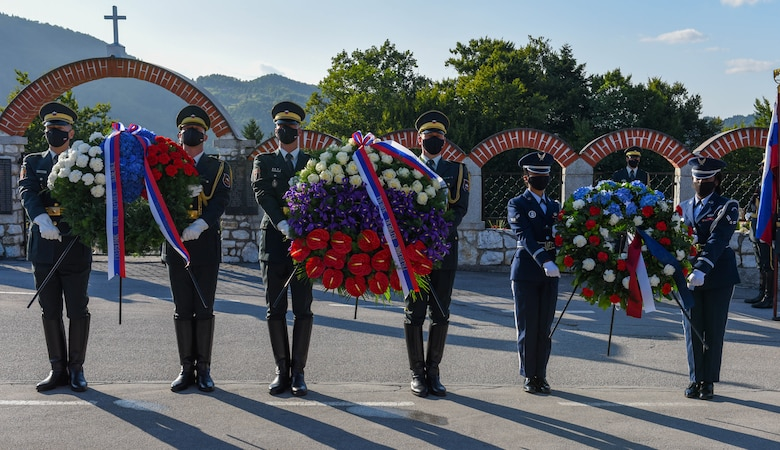 U.S. Air Force honor guard members assigned to the 31st Fighter Wing and Slovenian honor guard prepare to lay down a wreath in remembrance of the downed B-17 bomber 'Dark Eyes' which was shot down over Andraž on March 19, 1944, at the Andraž Memorial in Andraž nod Polzelo, Slovenia, Aug. 25, 2021. 'Dark Eyes' was shot down over Andraž nod Polzelo and the memorial to the B-17 Bomber was dedicated on March 22, 2014. (U.S. Air Force photo by Senior Airman Brooke Moeder)