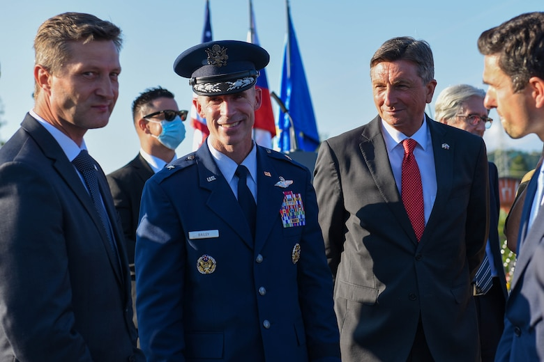 U.S. Air Force Brig. Gen. Jason E. Bailey, 31st Fighter Wing commander, middle, talks with Borut Pahor, Slovenian President of the Republic, right, and other leadership at the Andraž Memorial in Andraž nod Polzelo, Slovenia, Aug. 25, 2021. In 1944, the U.S. B-17 bomber 'Dark Eyes' was shot down over Andraž nod Polzelo and the memorial to 'Dark Eyes' was dedicated on March 22, 2014. Members of the crew killed in action are buried at the Florence American Cemetery, Florence, Italy. (U.S. Air Force photo by Senior Airman Brooke Moeder)