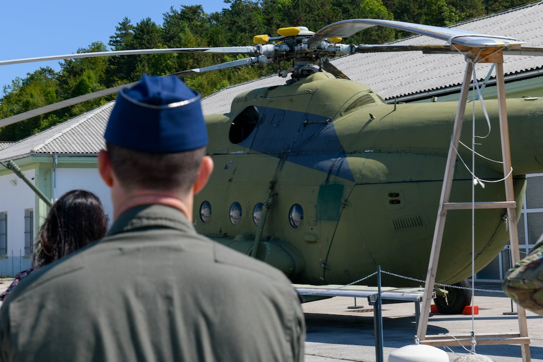 U.S. Air Force Lt. Col. Branden Felker, 31st Operational Support Squadron director of operations, looks at a helicopter at the Pivka Park of Military History in Pivka, Slovenia, Aug. 25, 2021. The museum is operated by the town of Pivka and the Slovenian Armed Forces and the exhibits illustrate history from World War II to the Cold War, the time frame of the former Socialist Federal Republic of Yugoslavia. (U.S. Air Force photo by Senior Airman Brooke Moeder)