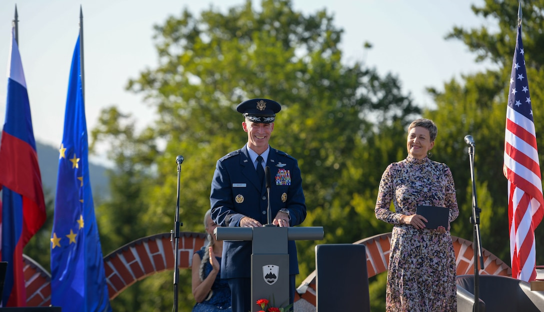 U.S. Air Force Brig. Gen. Jason E. Bailey, 31st Fighter Wing commander, speaks at the Andraž Memorial at Andraž nod Polzelo, Slovenia, Aug. 25, 2021. In 1944, the U.S. B-17 bomber 'Dark Eyes' was shot down over Andraž nod Polzelo and the memorial to 'Dark Eyes' was dedicated on March 22, 2014. 'Dark Eyes', part of the 96th Squadron, 2nd Bomber Group (Heavy), was on a mission to bomb the airdome at Klagenfurt, Austria, when it took on heavy flak, exploded, and went down. (U.S. Air Force photo by Senior Airman Brooke Moeder)