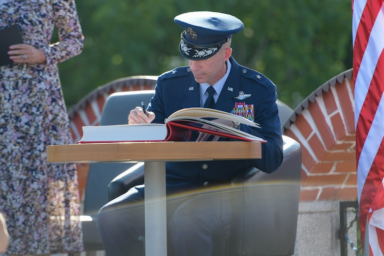 U.S. Air Force Brig. Gen. Jason E. Bailey, 31st Fighter Wing commander, signs a visitor's book at the Andraž ceremony in Andraž nod Polzelo, Slovenia, Aug. 25, 2021. In 1944, the U.S. B-17 bomber 'Dark Eyes' was shot down over Andraž nod Polzelo and the memorial to 'Dark Eyes' was dedicated on March 22, 2014. 'Dark Eyes,' is an American B-17 bomber that flew 80 missions during World War II in the skies above occupied France, Italy, and Nazi Germany. (U.S. Air Force photo by Senior Airman Brooke Moeder)