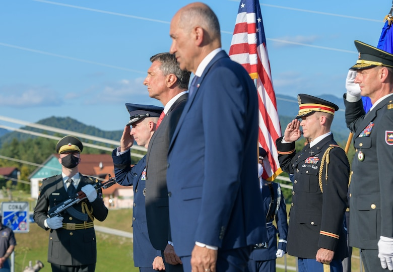 U.S. Air Force Brig. Gen. Jason E. Bailey, 31st Fighter Wing commander, left, Borut Pahor, Slovenian President of the Republic, middle, and Janez Jansa, Slovenian Prime Minister, right, commemorate a wreath dedicated to members with the U.S. B-17 bomber 'Dark Eyes' that was shot down in 1944 in Andraž nod Polzelo, Slovenia, Aug. 25, 2021. 'Dark Eyes', part of the 96th Squadron, 2nd Bomber Group (Heavy), was on a mission to bomb the airdome at Klagenfurt, Austria, when it took on heavy flak, exploded, and went down. (U.S. Air Force photo by Senior Airman Brooke Moeder)