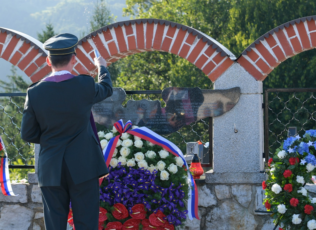 Military chaplain Matej Jakopic blesses a memorial plaque during the Andraž memorial in Andraž nod Polzelo, Slovenia, Aug. 25, 2021. In 1944, the U.S. B-17 bomber 'Dark Eyes' was shot down over Andraž nod Polzelo and the memorial to 'Dark Eyes' was dedicated on March 22, 2014. Members of the crew killed in action are buried at the Florence American Cemetery, Florence, Italy. (U.S. Air Force photo by Senior Airman Brooke Moeder)
