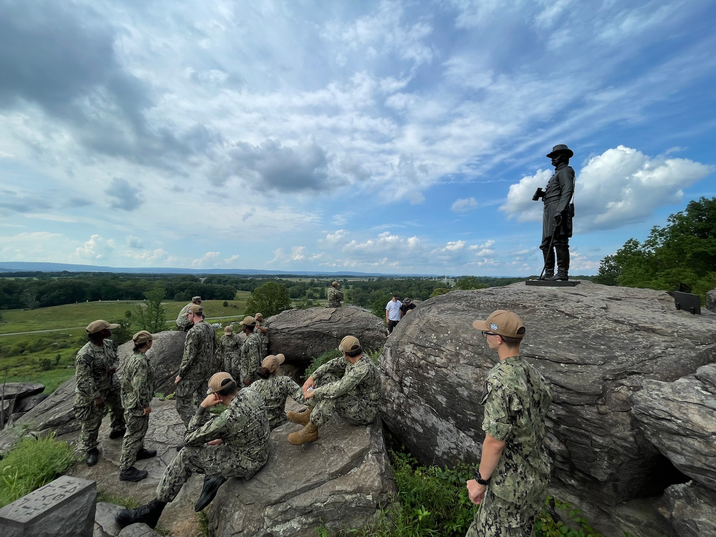 Sailors assigned to the guided-missile cruiser USS Gettysburg (CG 64) gather at Little Round Top, a historic landmark from the Battle of Gettysburg, prior to a day of preservation projects in Gettysburg National Park. Gettysburg Sailors traveled to Gettysburg, Pa. for a three-day namesake visit, where they performed several community relations projects and connected with the Gettysburg community. (U.S. Navy courtesy photo)
