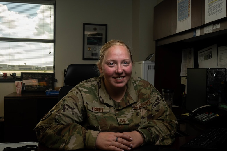 U.S. Air Force Tech. Sgt. Mandy Wright, a 23rd Special Operations Weather Squadron weather craftsman, pauses for a photo at Hurlburt Field, Florida, Aug. 19, 2021. Wright is responsible for monitoring storm systems, briefing prior to flying missions, and updating the wing commander on potential storm threats to base resources. U.S. Air Force photo by Staff Sgt. Rito Smith)