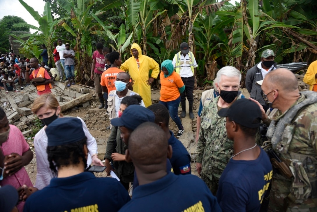 U.S. Navy Adm. Craig Faller, Commander of U.S. Southern Command, Administrator Samantha Power with United States Agency for International Development and U.S. Army Col. Steven Gventer, commander of Joint Task Force-Bravo, meet with relief workers in  Maniche, Haiti, Aug. 26, 2021.