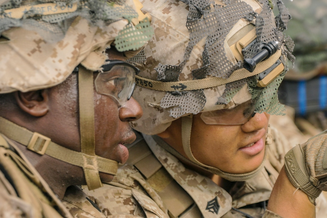 Sgt. Isaac Anderson (left) and Sgt. Lucas Low, squad leaders with Echo Company, 2nd Battalion, 23rd Marines, identify enemy positions on Range 410A during Integrated Training Exercise (ITX) 4-21 at Marine Corps Air Ground Combat Center, Twentynine Palms, California on July 30th, 2021.  ITX is the culmination of Marine Forces Reserve units' training cycle as they participate in a live-fire, combined arms exercise as a part of an integrated Marine Air Ground Task Force. (U.S. Marine Corps photo by Sgt. JVonnta Taylor)