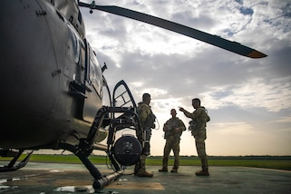 Sgt. Francisco Silva, Chief Warrant Officer two (CW2) Jean Rodriguez, and Chief Warrant Officer three (CW3) Norberto Martinez from the Puerto Rico Army National Guard Aviation conduct a crew-mission brief before departing to Port-au-Prince, Aug. 25, 2021
