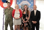 Sierra Palmer (second from left), an undersea warfare analyst at Naval Undersea Warfare Center Division Newport, is presented the Society of Women Engineers 2021 Helen Martha Sternberg Award by Amanda Rock (third from left), who represents the organization's New England Shoreline Section. Division Newport Commanding Officer Capt. Chad Hennings (left) and Technical Director Ron Vien congratulate Palmer during a ceremony held on July 15, 2021.