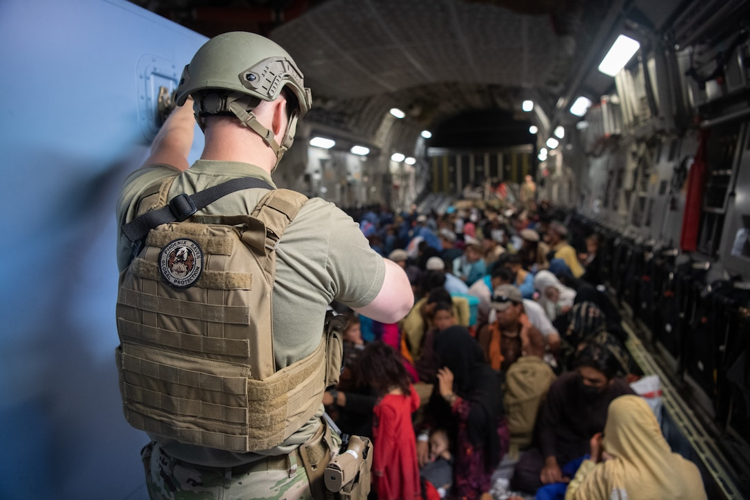 A U.S. Air Force security forces raven, assigned to the 816th Expeditionary Airlift Squadron, maintains security aboard a U.S. Air Force C-17 Globemaster III aircraft in support of the Afghanistan evacuation at Hamid Karzai International Airport (HKIA), Afghanistan, Aug. 24, 2021.