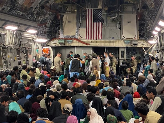 A newborn baby is cared for prior to departing a C-17 Globemaster III, August 23, 2021 at a Middle East staging area. A 315th Airlift Wing aircrew from Joint Base Charleston, S.C. helped deliver the baby while aboard a C-17 Globemaster III carrying Afghans evacuated from Afghanistan moments before landing at a Middle East staging area.