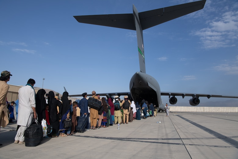 U.S. Air Force loadmasters and pilots assigned to the 816th Expeditionary Airlift Squadron, load passengers aboard a U.S. Air Force C-17 Globemaster III in support of the Afghanistan evacuation at Hamid Karzai International Airport (HKIA), Afghanistan, Aug. 24, 2021.