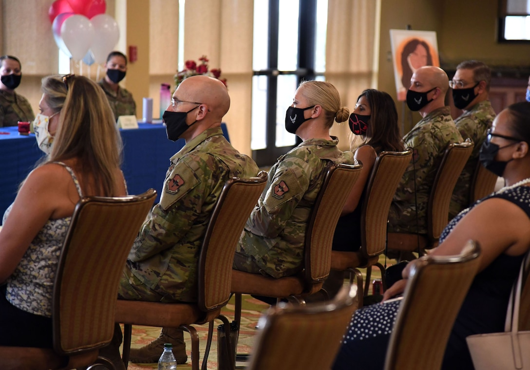 Keesler leadership and personnel attend the Women's Equality Day Celebration inside the Bay Breeze Event Center at Keesler Air Force Base, Mississippi, Aug. 26, 2021. The intention of the event, which included a panel discussion, was to highlight different perspectives of ongoing efforts to achieve women's equality. (U.S. Air Force photo by Kemberly Groue)