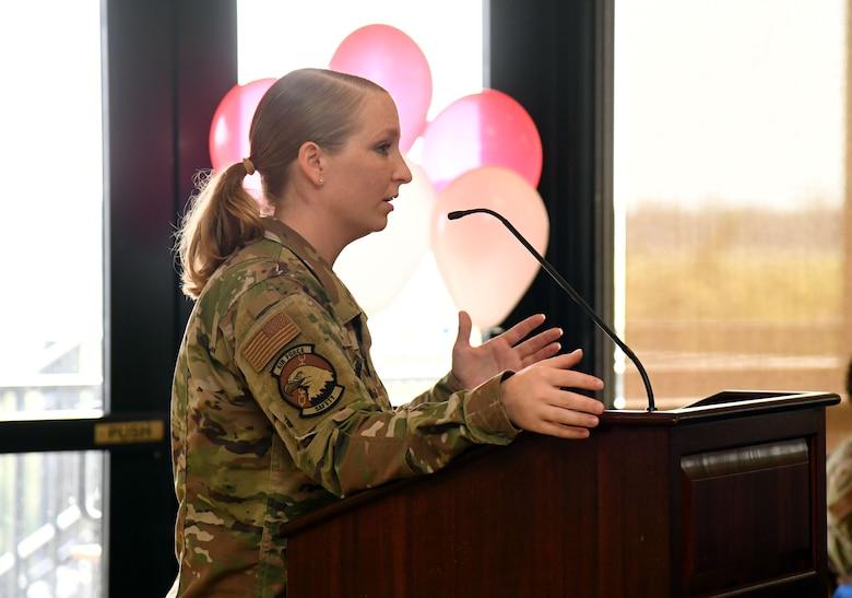 U.S. Air Force Staff Sgt. Taylor Boeckel, 81st Training Wing occupational safety technician, delivers remarks during the Women's Equality Day Celebration inside the Bay Breeze Event Center at Keesler Air Force Base, Mississippi, Aug. 26, 2021. The intention of the event, which included a panel discussion, was to highlight different perspectives of ongoing efforts to achieve women's equality. (U.S. Air Force photo by Kemberly Groue)
