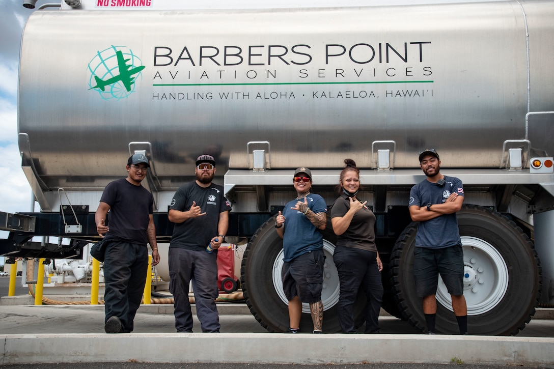 Barber's Point Aviation workers stand outside