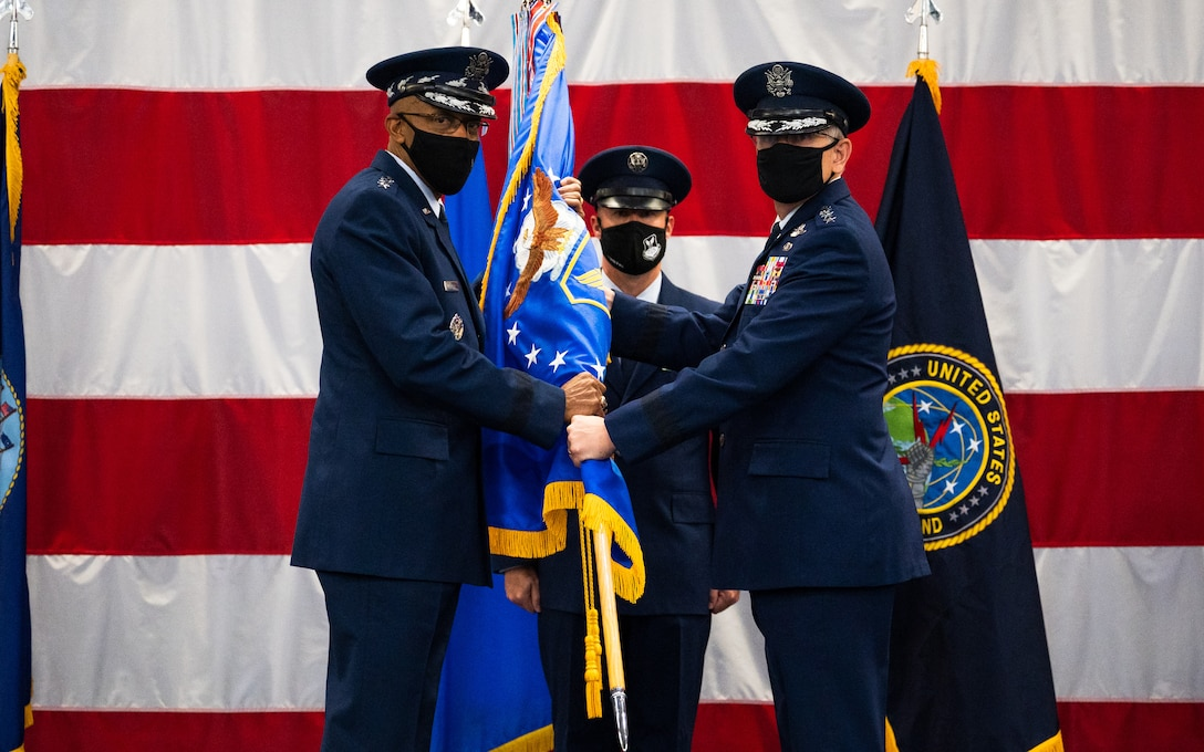Gen. Tim Ray, right, outgoing Air Force Global Strike Command commander, relinquishes the guidon to Air Force Chief of Staff Gen. CQ Brown, Jr., left, during the AFGSC change of command ceremony at Barksdale Air Force Base, Louisiana, Aug. 27, 2021. The passing of a unit's guidon symbolizes a transfer of command. (U.S. Air Force photo by Senior Airman Jacob B. Wrightsman)