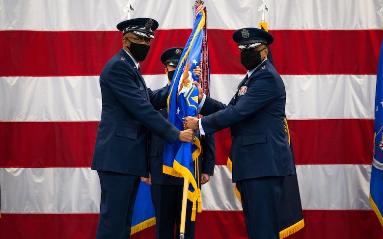 Gen. Anthony Cotton, right, incoming Air Force Global Strike Command commander, receives the guidon from Air Force Chief of Staff Gen. CQ Brown, Jr., left, during the AFGSC change of command ceremony at Barksdale Air Force Base, Louisiana, Aug. 27, 2021. The passing of a unit's guidon symbolizes a transfer of command. (U.S. Air Force photo by Senior Airman Jacob B. Wrightsman)