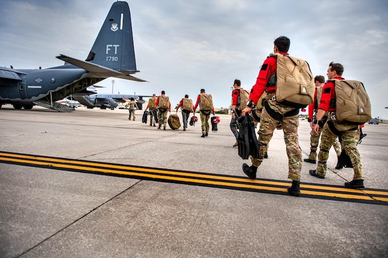 Photo of Airmen boarding an aircraft