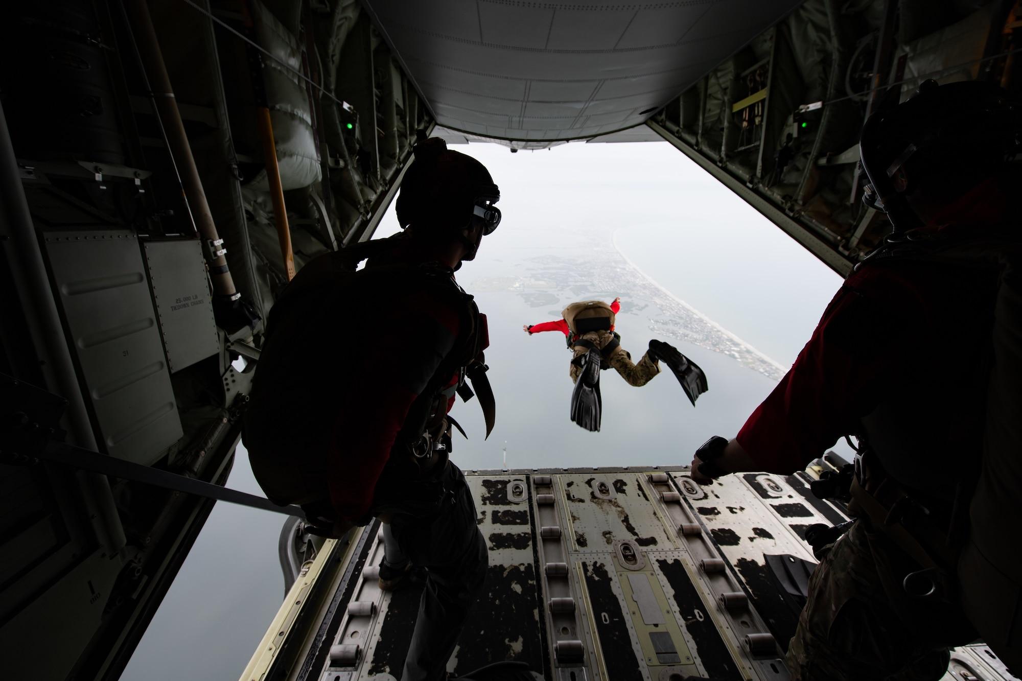 Photo of Airman jumping off an aircraft