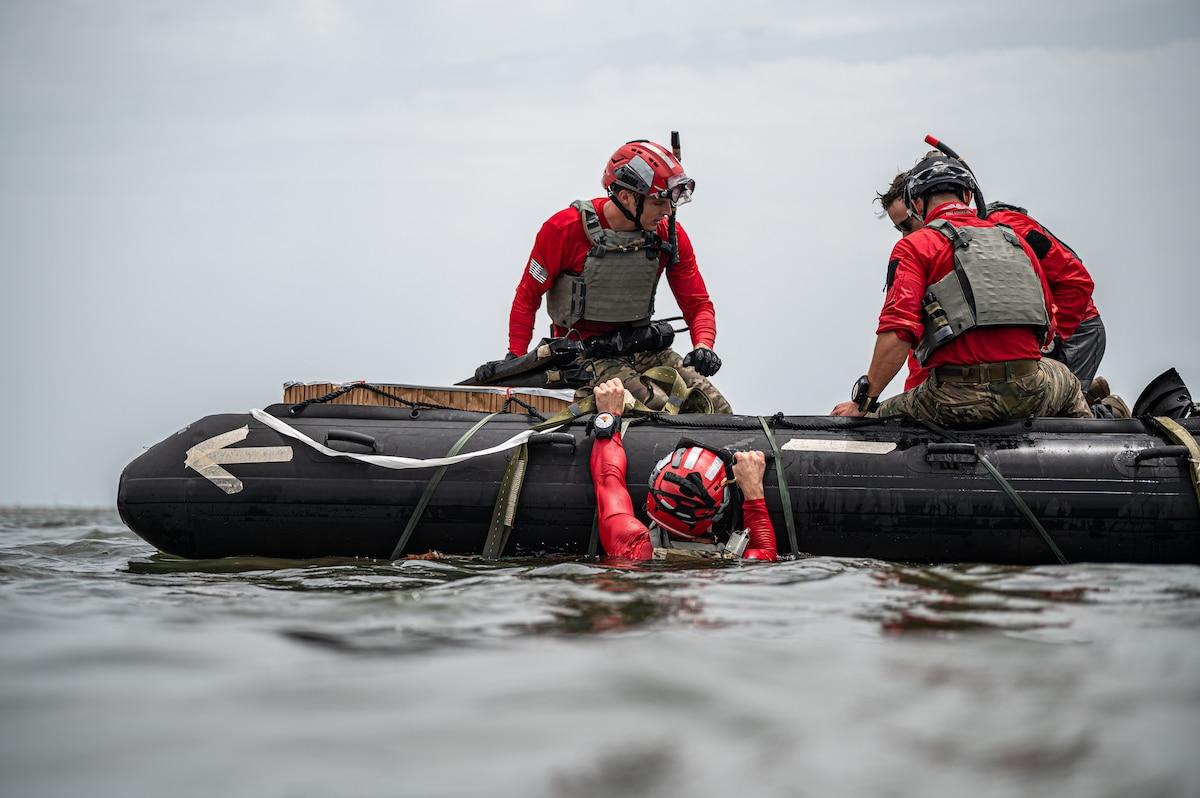 Photo of Airman climbing into a boat