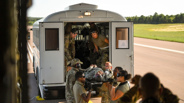 U.S. Airmen offload a C-130J Super Hercules aircraft assigned to the 815th Airlift Squadron, Keesler Air Force Base, Mississippi, for aeromedical evacuation training during exercise Patriot Warrior at Fort McCoy, Wisconsin, Aug. 13, 2021. Patriot Warrior is Air Force Reserve Command's premier exercise providing Airmen an opportunity to train with joint and international partners in airlift, aeromedical evacuation, and mobility support. The exercise builds on capabilities for the future fight, increasing the readiness, lethality and agility of the Air Force Reserve. (U.S. Air Force Photo by Tech. Sgt. Corban Lundborg)