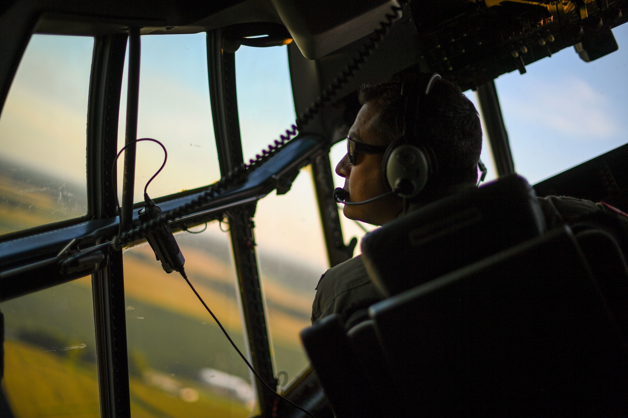 Maj. Aaron Sanchez, 815th Airlift Squadron pilot assigned to the 403rd Wing, Keesler Air Force Base, Mississippi, flies a U.S. Air Force C-130J Super Hercules aircraft from Fort McCoy Army Airfield for aeromedical evacuation training during exercise Patriot Warrior at Fort McCoy, Wisconsin, Aug. 14, 2021. Patriot Warrior is the Air Force Reserve Command's premier exercise providing Airmen an opportunity to train with joint and international partners in airlift, aeromedical evacuation, and mobility support. The exercise builds on capabilities for the future fight, increasing the readiness, lethality and agility of the Air Force Reserve. (U.S. Air Force Photo by Tech. Sgt. Corban Lundborg)