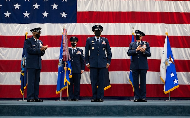 Gen. Anthony Cotton, incoming Air Force Global Strike Command commander, is congratulated by Air Force Chief of Staff Gen. CQ Brown, Jr., left, and Gen. Timothy Ray, right, outgoing AFGSC commander, during the AFGSC change of command ceremony at Barksdale Air Force Base, Louisiana, Aug. 27, 2021. Activated in 2009, AFGSC is responsible for the nation's three intercontinental ballistic missile wings, the Air Force's entire bomber force, Air Force Nuclear Command, Control and Communications systems, and operational and maintenance support to organizations within the nuclear enterprise. (U.S. Air Force photo by Senior Airman Jacob B. Wrightsman)
