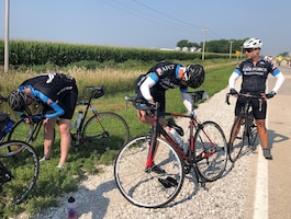 Members of the Air Force Cycling Team make adjustments to their bikes during the Register's Annual Great Bicycle Race Across Iowa, July 25-31, 2021. RAGBRAI, as it's commonly known, is the longest, largest and oldest recreational bicycle touring event in the world. Among the Air Force riders was Office of Special Investigations Special Agent Carlos Vargasgonzalez. (Photo by SA Carlos Vargasgonzalez)