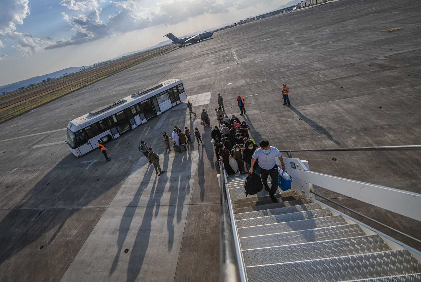 Evacuees from Afghanistan board a Boeing 777 bound for the United States from Naval Air Station Sigonella, Aug. 28, 2021. NAS Sigonella is currently supporting the Department of State mission to facilitate the safe departure and relocation of U.S. citizens, Special Immigration Visa recipients, and vulnerable populations from Afghanistan.