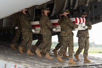 A U.S. Marine Corps carry team transfers the remains of Marine Corps Lance Cpl. Kareem M. Nikoui of Norco, California, Aug. 29, 2021 at Dover Air Force Base, Delaware. Nikoui was assigned to 2nd Battalion, 1st Marine Regiment, 1st Marine Division, I Marine Expeditionary Force, Camp Pendleton, California. (U.S. Air Force photo by Jason Minto)