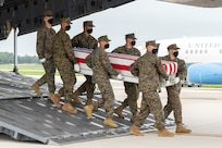 A U.S. Marine Corps carry team transfers the remains of Marine Corps Lance Cpl. Dylan R. Merola of Rancho Cucamonga, California, Aug. 29, 2021 at Dover Air Force Base, Delaware. Merola was assigned to 2nd Battalion, 1st Marine Regiment, 1st Marine Division, I Marine Expeditionary Force, Camp Pendleton, California. (U.S. Air Force photo by Jason Minto)
