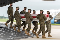 A U.S. Marine Corps carry team transfers the remains of Marine Corps Lance Cpl. David L. Espinoza of Rio Bravo, Texas, Aug. 29, 2021 at Dover Air Force Base, Delaware. Espinoza was assigned to 2nd Battalion, 1st Marine Regiment, 1st Marine Division, I Marine Expeditionary Force, Camp Pendleton, California. (U.S. Air Force photo by Jason Minto)