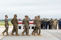 A U.S. Marine Corps carry team transfers the remains of Marine Corps Cpl. Humberto A. Sanchez of Logansport, Indiana, Aug. 29, 2021 at Dover Air Force Base, Delaware. Sanchez was assigned to 2nd Battalion, 1st Marine Regiment, 1st Marine Division, I Marine Expeditionary Force, Camp Pendleton, California. (U.S. Air Force photo by Jason Minto)