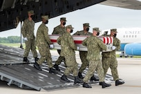 A U.S. Navy carry team transfers the remains of Navy Hospitalman Maxton W. Soviak of Berlin Heights, Ohio, Aug. 29, 2021 at Dover Air Force Base, Delaware. Soviak was assigned to 1st Marine Regiment, 1st Marine Division, Camp Pendleton, California. . (U.S. Air Force photo by Jason Minto)