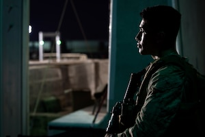 210824-N-ZA692-0755 U.S. 5TH FLEET AREA OF OPERATIONS (Aug. 24, 2021) – A U.S. Marine stands security watch in support of U.S. citizens and evacuees arriving from Afghanistan at a location in the U.S. 5th Fleet area of operations prior to onward travel to the United States. The U.S. 5th Fleet region encompasses nearly 2.5 million square miles of water area and is comprised of 20 countries.