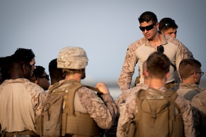 210826-N-ZA692-0259 U.S. 5TH FLEET AREA OF OPERATIONS (Aug. 26, 2021) – U.S. Marines standby to assist U.S. citizens and evacuees arriving from Afghanistan at a location in the U.S. 5th Fleet area of operations prior to onward travel to the United States. The U.S. 5th Fleet region encompasses nearly 2.5 million square miles of water area and is comprised of 20 countries.