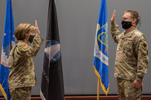 Col. Katharine G. Barber (left), commander of the Air Force Technical Applications Center at Patrick Space Force Base, Fla., administers the oath of office to Col. Richard R. Beckman to induct him into the U.S. Space Force.  Beckman is AFTAC's first vice commander to serve as a member of the newest branch of the Department of Defense.  (U.S. Air Force photo by Matthew S. Jurgens)