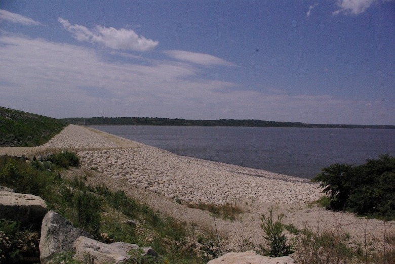 Upstream side of Tuttle Creek Dam east parking area looking west.    Work is expected to begin on or about September 7, 2021 and will require closure of public access, including the east and west dam parking lots and the entire upstream face of the dam. These closures include all pedestrian and bank fishing.