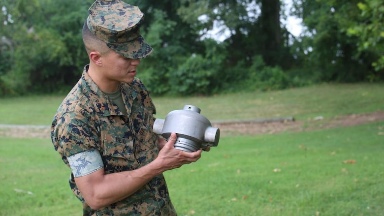 CWO2 Justin Trejo, a project officer with the Program Manager for Ammunition at Marine Corps Systems Command, displays a 3D-printed headcap for a rocket motor used to employ a M58 Mine Clearing Line Charge, July 21 at Marine Corps Base Quantico, Virginia. MCSC successfully developed and tested the headcap to support the Marine Corps' mine-clearing missions.