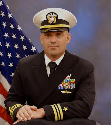 Official portrait of Lt. Cmdr. Casey Rogers