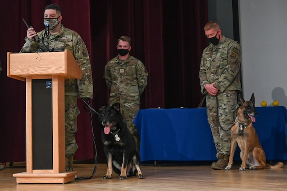 MWD Baxi is honored with a last call during a retirement ceremony at Kirtland Air Force Base.
