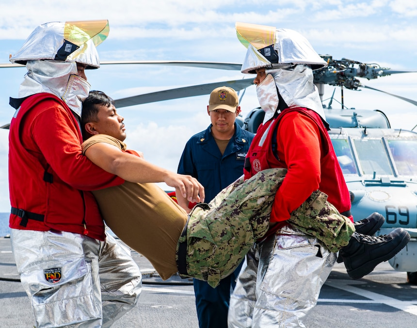 Sailors participate in an aircraft firefighting and medical training exercise aboard the Independence-variant littoral combat ship USS Tulsa (LCS 16), Aug. 27, 2021.